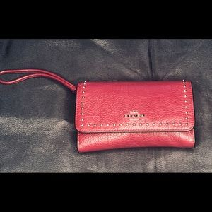 Coach leather wristlet with stud detail